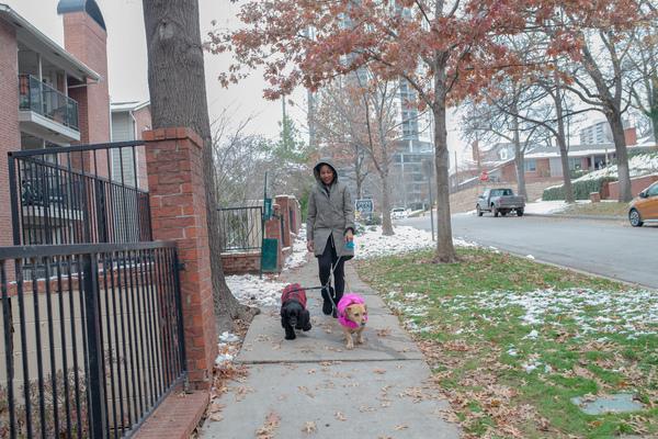 Jaleesa Garland walks her dogs around her new Tulsa neighborhood.