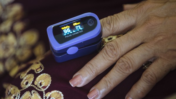 A paramedic used a pulse oximeter to check a patient