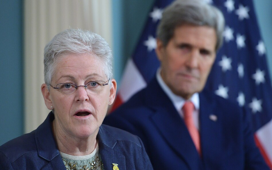 Then-Environmental Protection Agency Administrator Gina McCarthy speaks during a 2015 signing ceremony for an air quality agreement as then-Secretary of State John Kerry looks on. The two will be back together working on climate issues in the Biden administration. (Mandel Ngan/AFP via Getty Images)