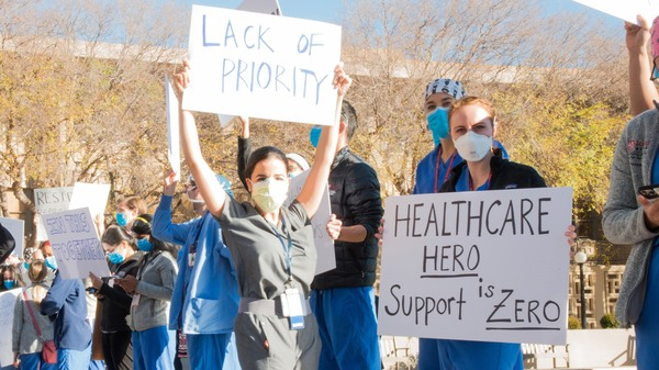 Medical residents and fellows protest the university