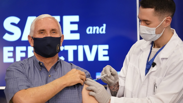 Vice President Mike Pence receives a Pfizer-BioNTech COVID-19 vaccine shot at the Eisenhower Executive Office Building on the White House complex on Dec. 18.