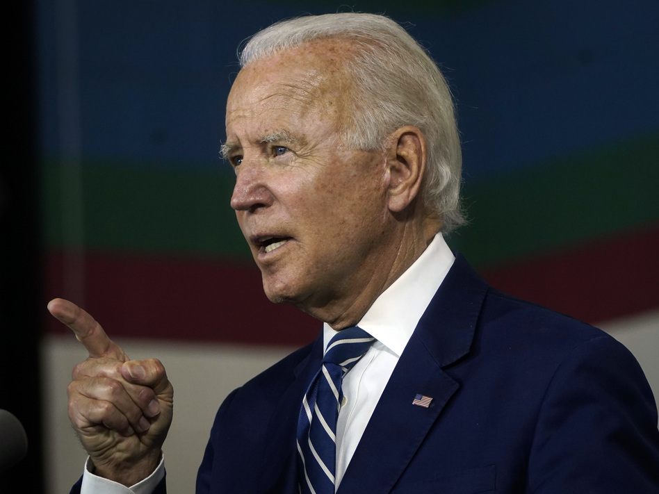 Joe Biden speaks about economic recovery during a campaign event at Colonial Early Education Program at the Colwyck Center in July. In an interview with Stephen Colbert, the president-elect defended his son Hunter, whose tax affairs are under investigation. (Drew Angerer/Getty Images)