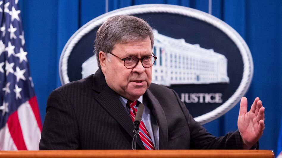 Attorney General William Barr holds a news conference on Monday. (Michael Reynolds/Pool/AFP via Getty Images)