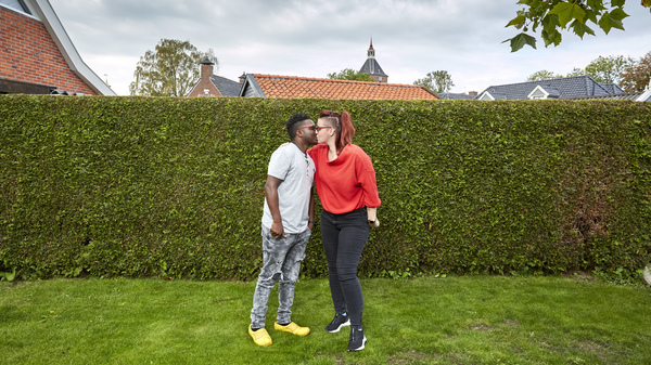 Patrick Phiri of Malawi and fiance Fiona ten Have of Holland kiss in her parents