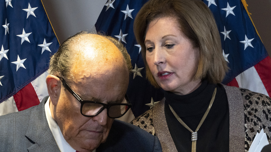 Rudy Giuliani, President Trump's personal attorney, with lawyer Sidney Powell last month in Washington. They, the Trump campaign and others face a lawsuit by an employee of Dominion Voting Systems, a vendor that has been the subject of disinformation from Trump and his allies. (Jacquelyn Martin/AP)