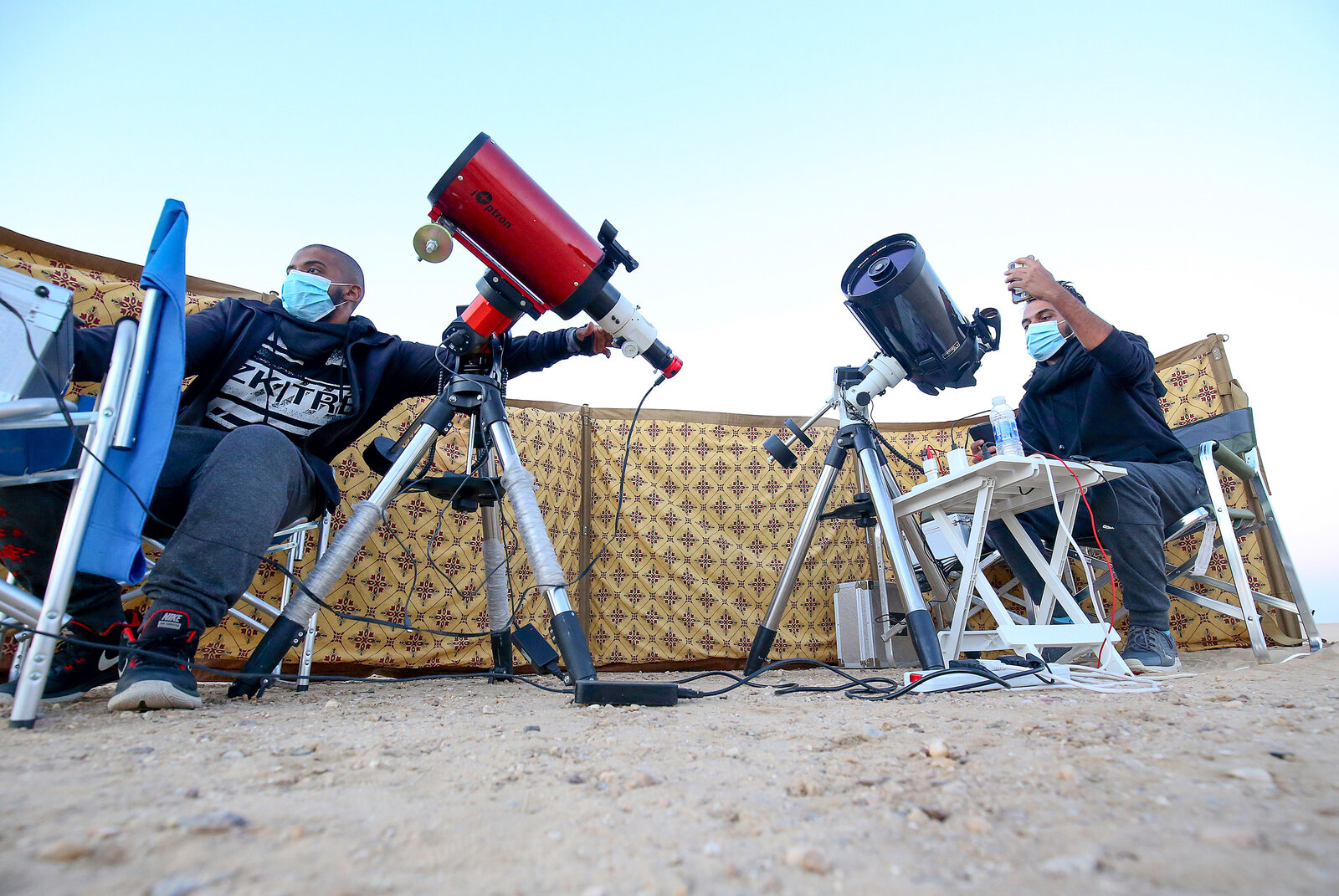 Kuwaiti astrophotographers Mohammad al-Obaidi, right, and Abdullah al-Harbi follow the Great Conjunction in al-Salmi district, a desert area west of Kuwait City.