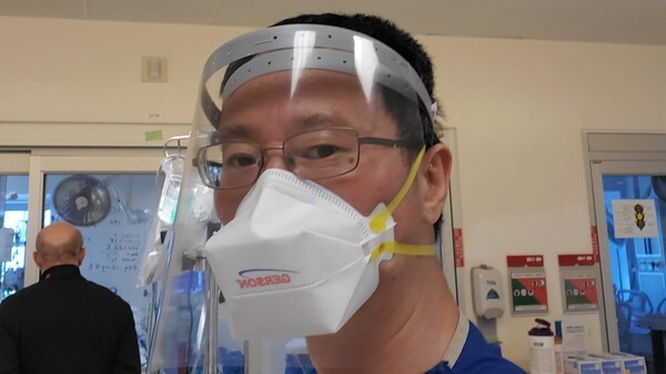 Jun Jai during a shift last July in the ICU at Los Angeles County+USC Medical Center. He says now the work load is the worst he