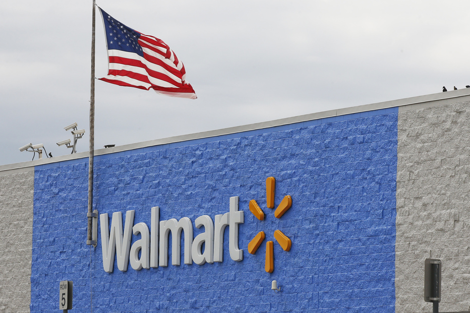 """On Tuesday, the Justice Department filed a civil suit accusing Walmart of failing to stop """"hundreds of thousands"""" of improper opioid transactions at its chain of pharmacies. (Sue Ogrocki/AP)"""
