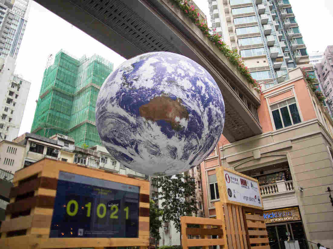 HONG KONG, CHINA - 2019/03/30: Earth Globe 'Gaia' by artist Luke Jerram set up to raise awareness about global warming seen in the Wan Chai district of Hong Kong Island. (Photo by Guillaume Payen/SOPA Images/LightRocket via Getty Images)