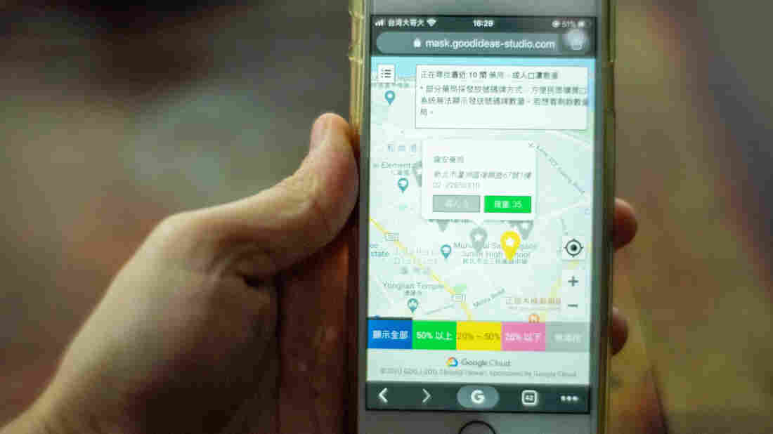 A Taiwanese new system app on a smartphone to find the closest pharmacies to buy face masks in New Taipei.