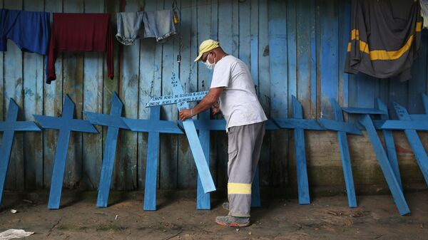 Ulisses Xavier, 52, who has worked for 16 years at Nossa Senhora cemetery in Manaus, Brazil, makes wooden crosses to supplement his income. The cemetery has seen a surge in the number of new graves after the outbreak of COVID-19.