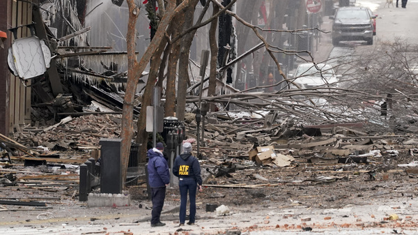 Emergency personnel work near the scene of an explosion in downtown Nashville on Friday. Law enforcement is seeking suspects, and the governor has asked for a federal emergency declaration.