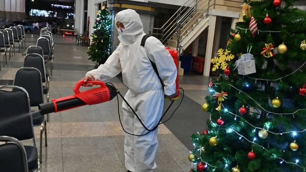 A worker wearing personal protective equipment disinfects the Holy Redeemer Church in Bangkok after a Christmas Eve mass. Thailand is one of many countries now seeing a surge in cases.