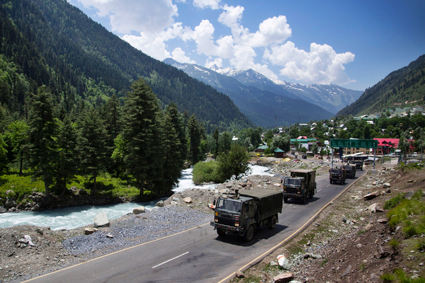 An Indian army convoy moves on the Srinagar-Ladakh highway at Gagangeer, northeast of Srinagar, India, on June 17. China said it was seeking a peaceful resolution with India following the death of 20 Indian soldiers in the most violent confrontation between the two countries in decades.