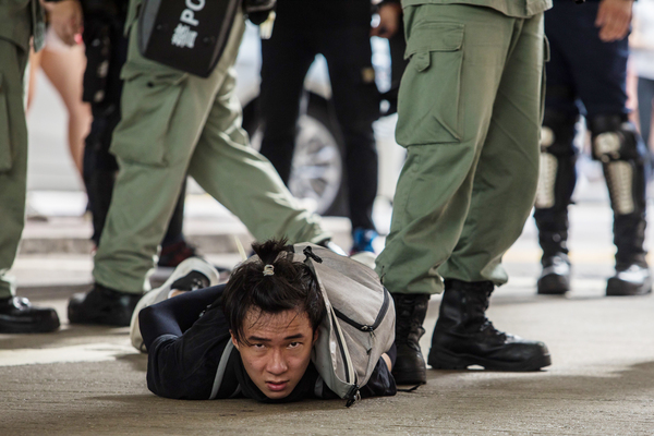 Riot police detain a man as they clear protesters demonstrating against a new national security law in Hong Kong on July 1, the 23rd anniversary of the city's handover from Great Britain to China.