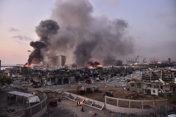 Smoke rises after a massive blast at the Beirut port on Aug. 4. The explosion killed nearly 200 people, wounded thousands and caused destruction across half the city. The blast was caused by a fire that ignited nearly 3,000 tons of ammonium nitrate stored in the port.