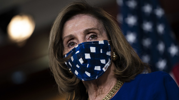 House Speaker Nancy Pelosi, D-Calif., is pictured on Capitol Hill on Nov. 20. The House voted Monday to increase direct payments to Americans above what is provided in the COVID-19 relief legislation President Trump signed on Sunday.