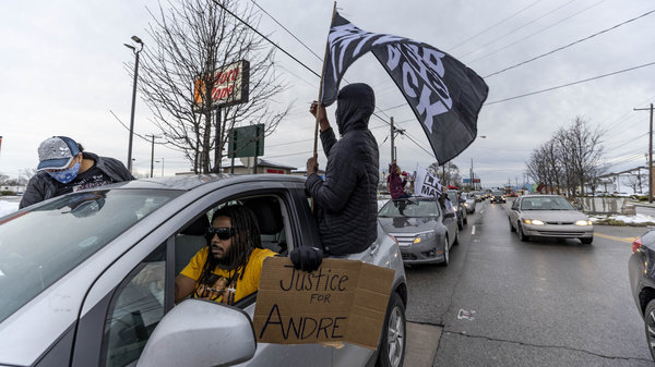 Advocates against police brutality organized a caravan protest after the killing of Andre Hill in Columbus, Ohio.  Officer Adam Coy was fired from the Columbus Police Department on Monday for his role in fatally shooting the 47-year-old on Dec. 22.