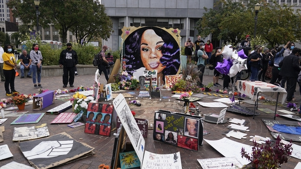 In this Wednesday, Sept. 23, 2020, people gather in Jefferson Square in Louisville, awaiting word on charges against police officers in the death of Breonna Taylor.