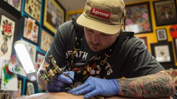 Billy White, owner of Red Rose Tattoo in Zanesville, Ohio, will cover up people's previous racist tattoos. But first he ensures it reflects a genuine change in ideology. He's seen more interest in covering up tattoos this year than before.