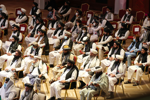 Following a U.S.-Taliban agreement in February, a Taliban delegation attends the opening session of peace talks with Afghan government representatives in Doha, Qatar, on Sept. 12.