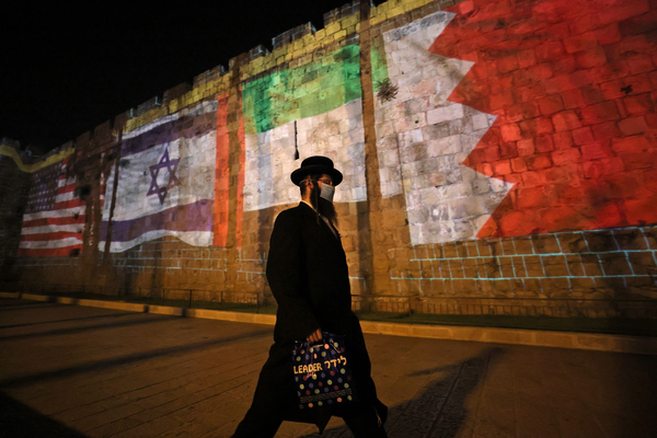 The flags of the U.S., Israel, United Arab Emirates and Bahrain are projected on the ramparts of Jerusalem's Old City on Sept. 15, in a show of support for Israel's normalization deals with the United Arab Emirates and Bahrain.