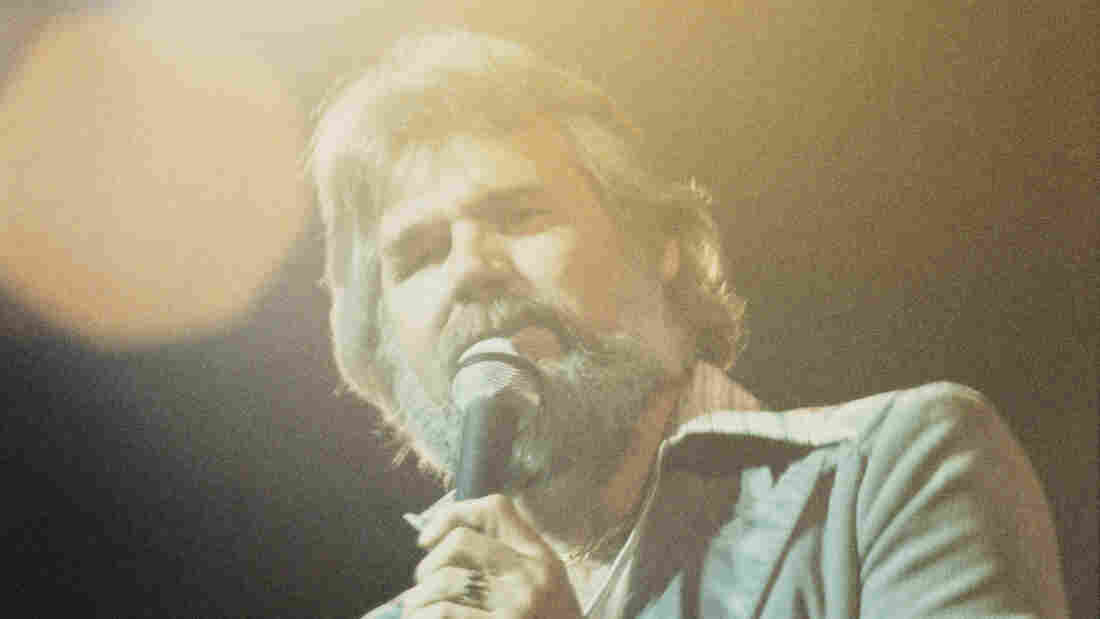 American singer and songwriter Kenny Rogers in concert, circa 1977.