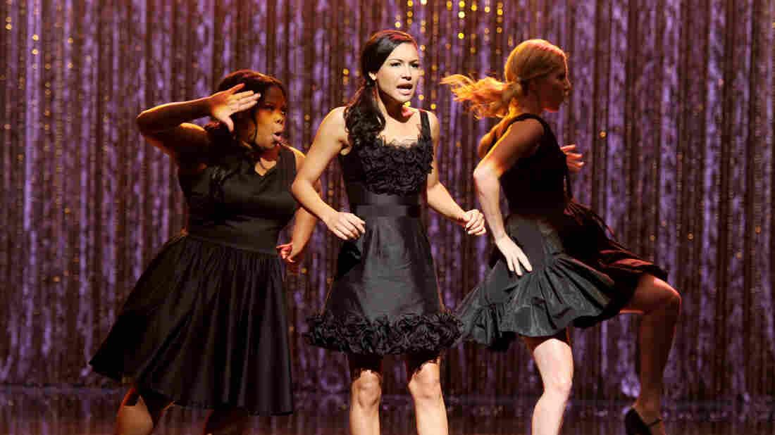 Naya Rivera (center) on the set of Glee.