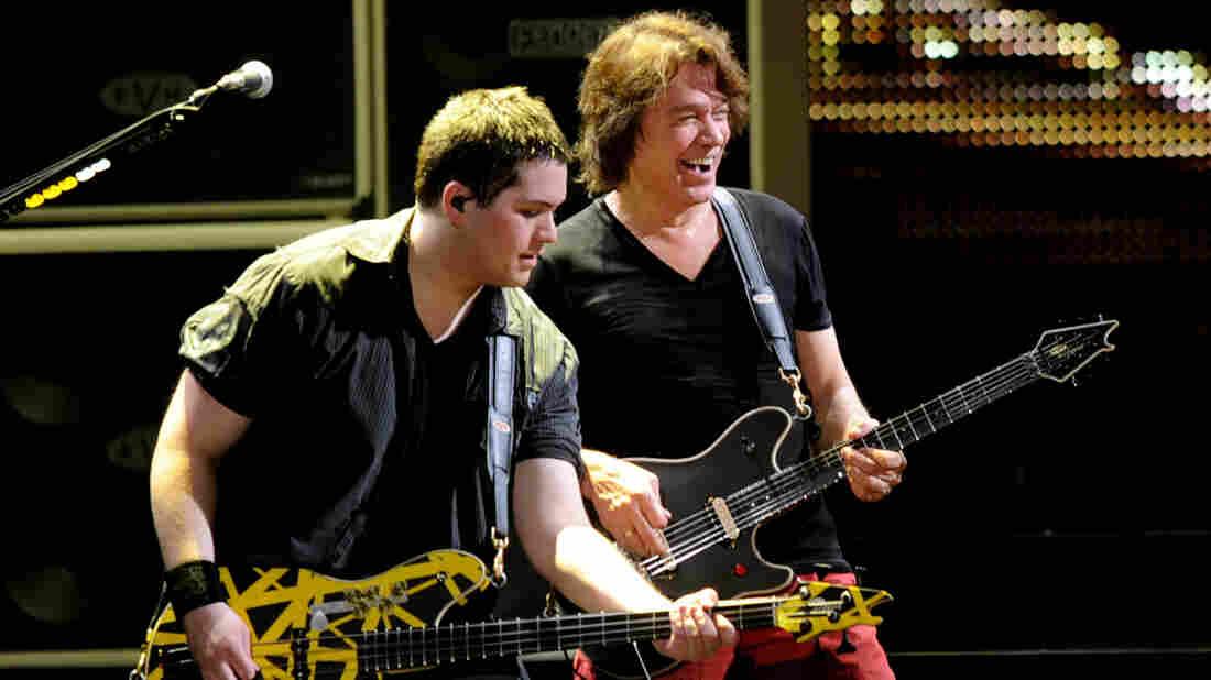 Eddie Van Halen (right) on stage with his son Wolfgang Van Halen in 2012.