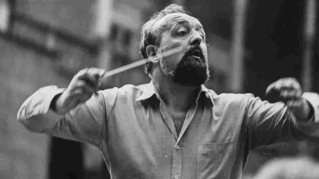 Polish composer Krzysztof Penderecki pictured conducting an orchestra, 1980.