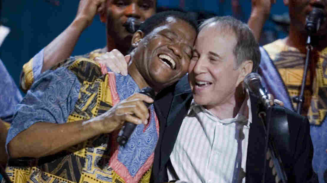 Paul Simon (center), Joseph Shabalala (left) and other members of Ladysmith Black Mambazo perform during the Library Of Congress Gershwin Prize For Popular Song Gala at the Warner Theater May 23, 2007 in Washington, DC.