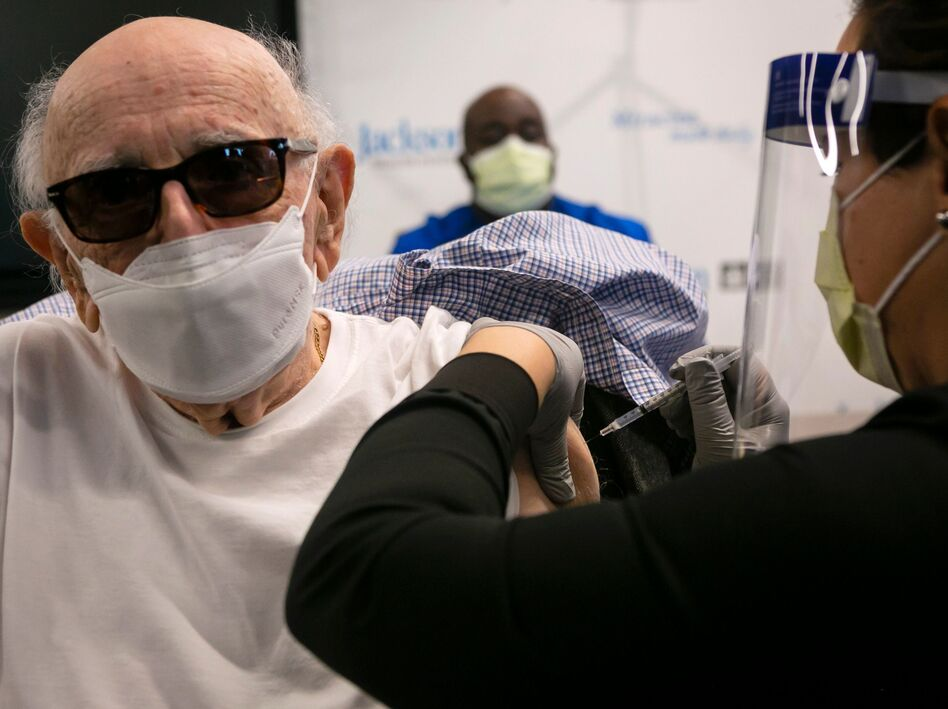 Norman Einspruch, 88, a cardiology patient at Jackson Memorial Hospital in Miami, Fla., receives his first dose of the Pfizer-BioNtech COVID-19 vaccine Dec. 30. (Eva Marie Uzcategui/AFP via Getty Images)