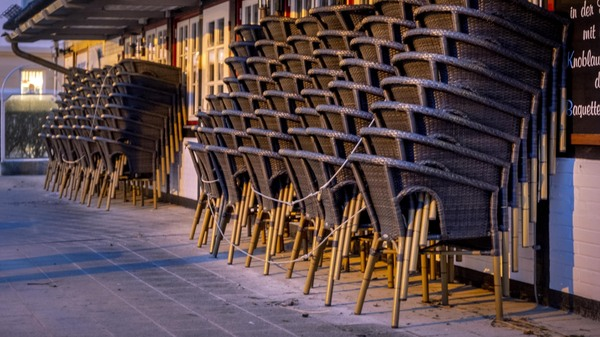 Chairs are piled up outside a restaurant in the Baltic Sea resort town of Haffkrug, Germany, on Monday. To avoid the outspread of the new coronavirus all restaurants in Germany are closed.