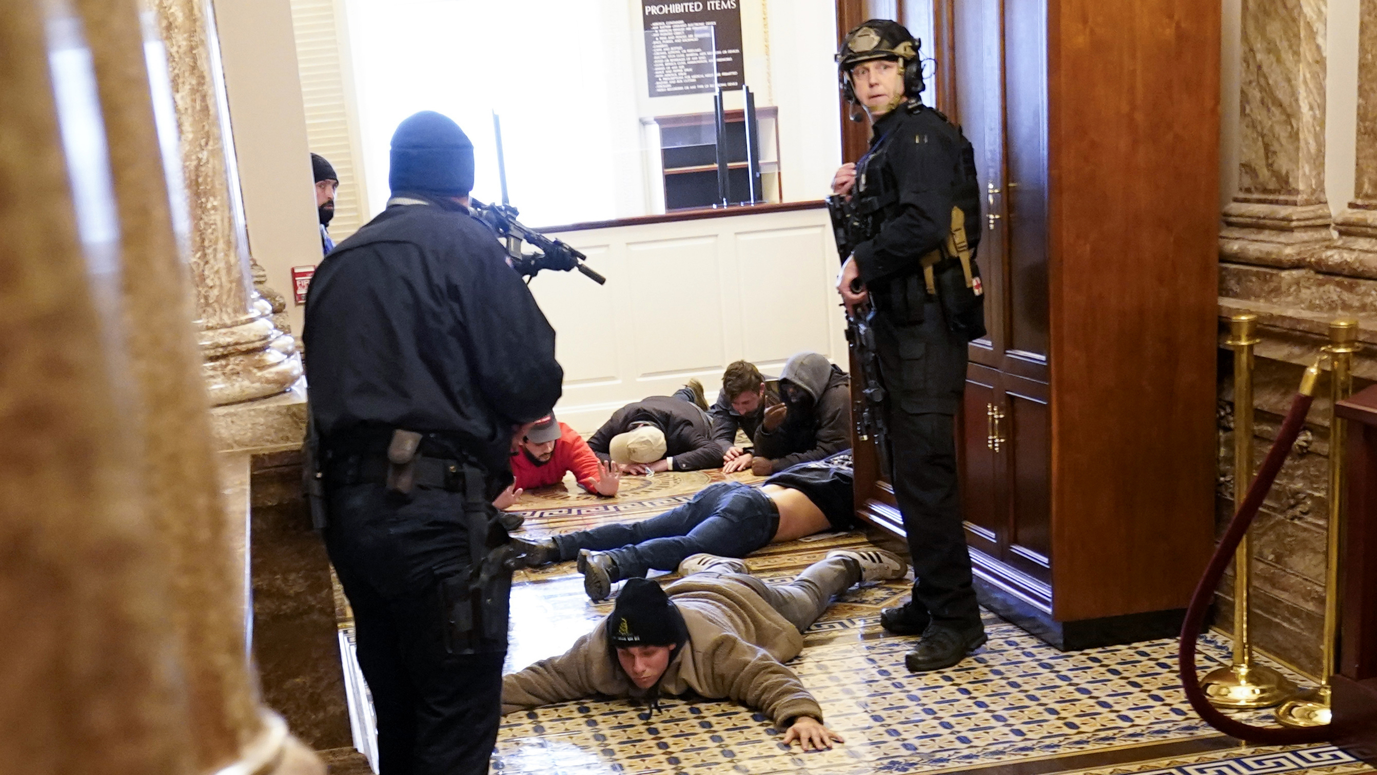 U.S. Capitol Police hold protesters at gunpoint near the House Chamber inside the U.S. Capitol on Wednesday.