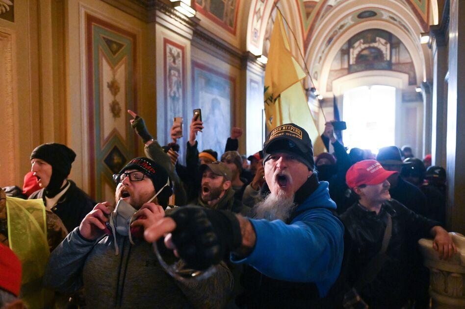 Demonstrators breached security and entered the Capitol on Wednesday as Congress debated the 2020 electoral vote tally. (Roberto Schmidt/AFP via Getty Images)
