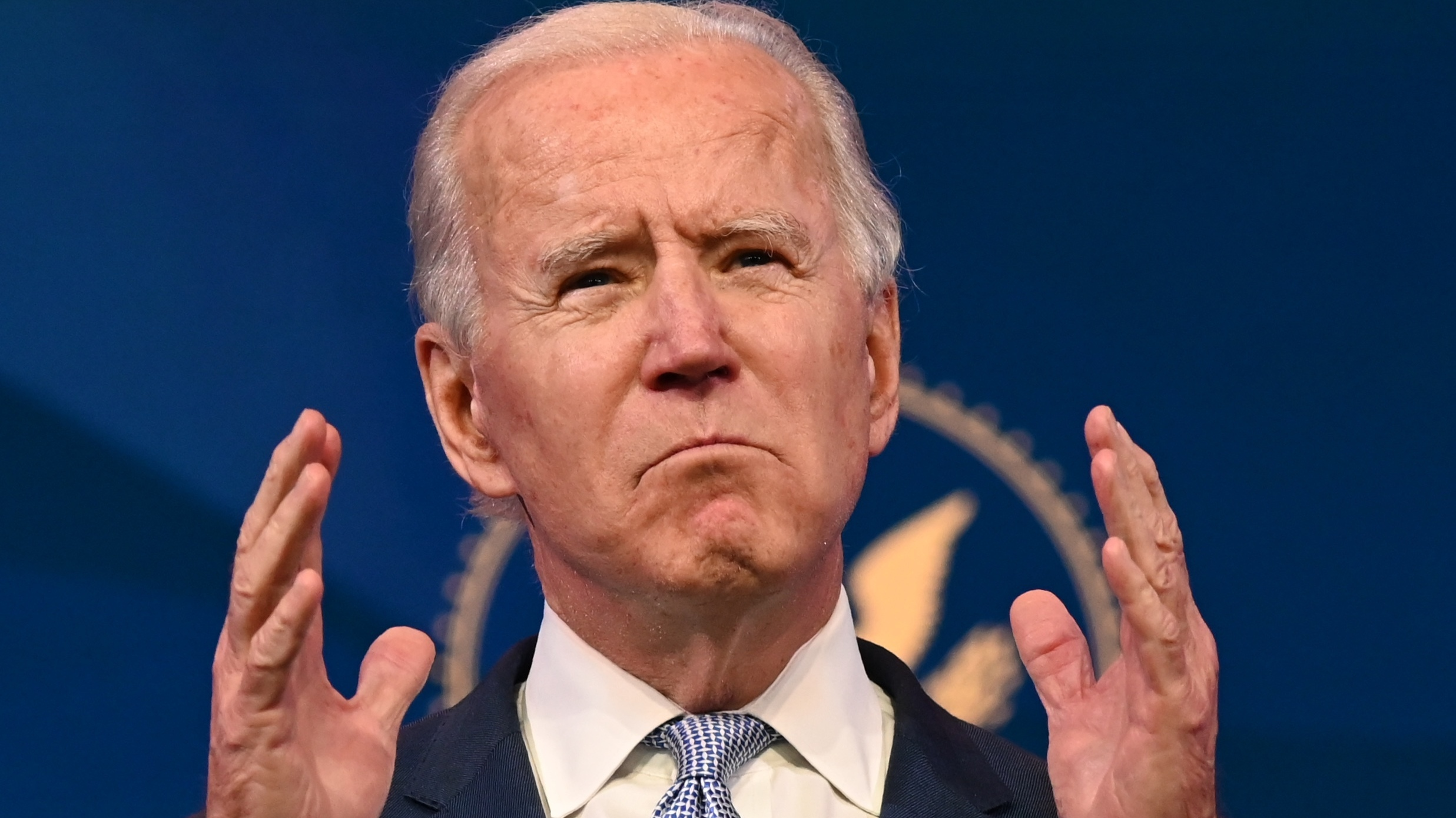 """President-elect Joe Biden said U.S. democracy is """"under unprecedented assault"""" in remarks on the storming of the U.S. Capitol by pro-Trump extremists on Wednesday. Above, he speaks at the Queen Theater in Wilmington, Del., on Tuesday."""