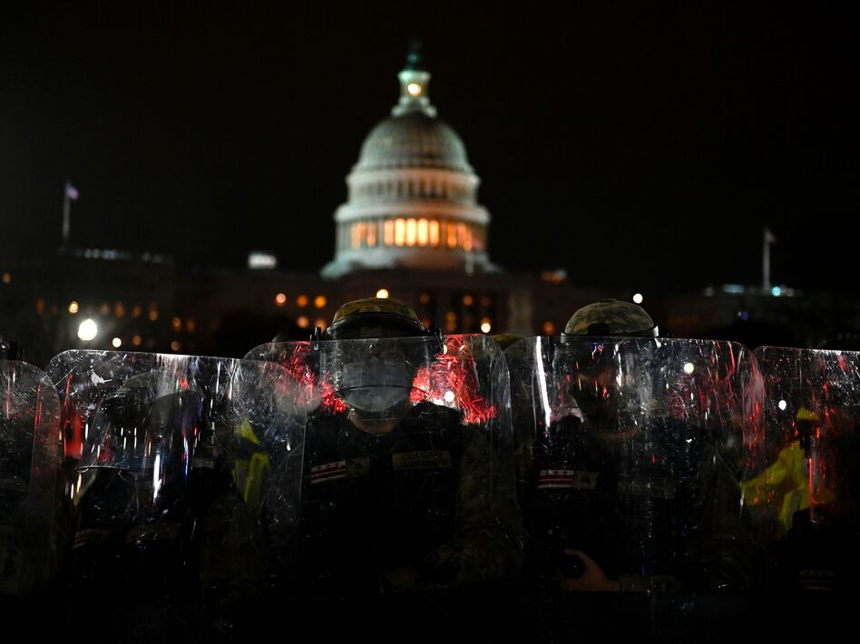 Members of the D.C. National Guard are deployed outside of the U.S. Capitol on Wednesday evening. Supporters of President Trump stormed a session of Congress earlier Wednesday. (Andrew Caballero-Reynolds/AFP via Getty Images)