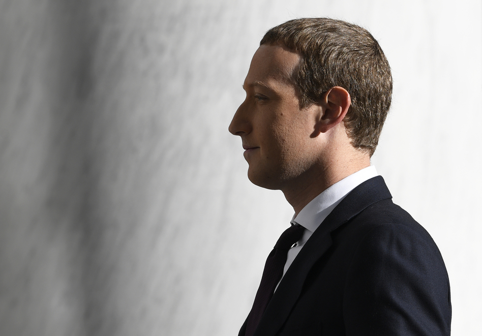 Facebook Chief Executive Officer Mark Zuckerberg arrives for a hearing before the House Financial Services Committee on Capitol Hill in October 2019. (Susan Walsh/AP)