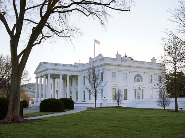An American flag flies over the White House on Thursday.