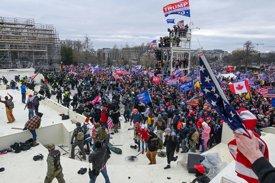 Pro-Trump extremists clash with police and security forces as they invade the Inauguration Day platform on Wednesday. Security forces were quickly overrun as the mob reached the Capitol. (Roberto Schmidt/AFP via Getty Images)