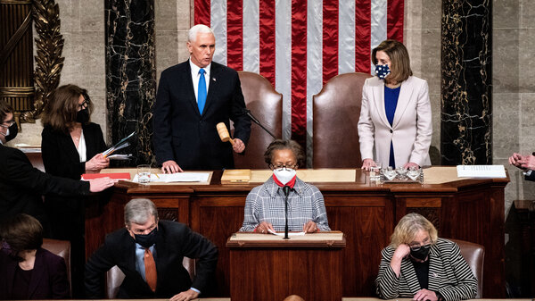 Vice President Pence and House Speaker Nancy Pelosi, D-Calif., preside over a joint session of Congress to ratify President-elect Joe Biden's 306-232 Electoral College win over President Trump, hours after a pro-Trump mob broke into the U.S. Capitol and disrupted proceedings.