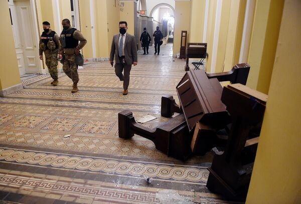 Rioters damaged the U.S. Capitol after they breached security and entered the building during a session of Congress on Wednesday to tally the 2020 electoral votes.