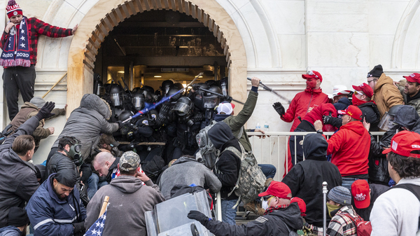 "A mob of pro-Trump extremists clash with police as they try to enter the U.S. Capitol, hoping to overthrow the results of the 2020 election. Washington, D.C., Mayor Muriel Bowser calls the violent takeover of the Capitol building a case of ""domestic terrorism."""