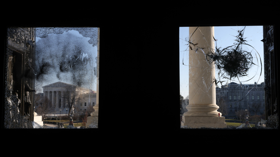 The U.S. Supreme Court is seen through a broken window at an entrance of the U.S. Capitol Wednesday. (Alex Wong/Getty Images)
