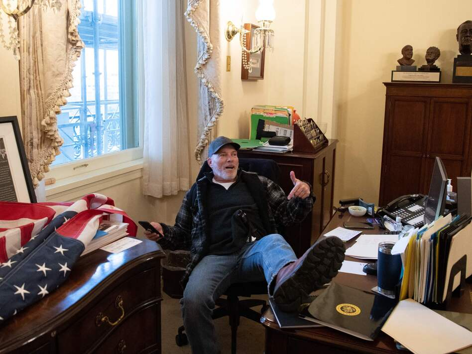 Richard Barnett has been arrested in his home state of Arkansas and faces charges related to his part in the forced entry into the Capitol. During the riot, Barnett sat in House Speaker Nancy Pelosi's office. (Saul Loeb/AFP via Getty Images)