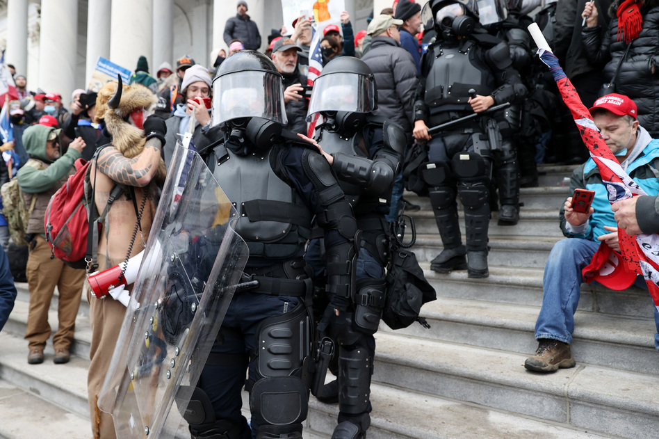 U.S. Capitol police officers make their way through pro-Trump extremists who stormed the Capitol building on Wednesday. (Tasos Katopodis/Getty Images)