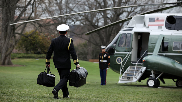 In March 2018, a White House military aide carries the
