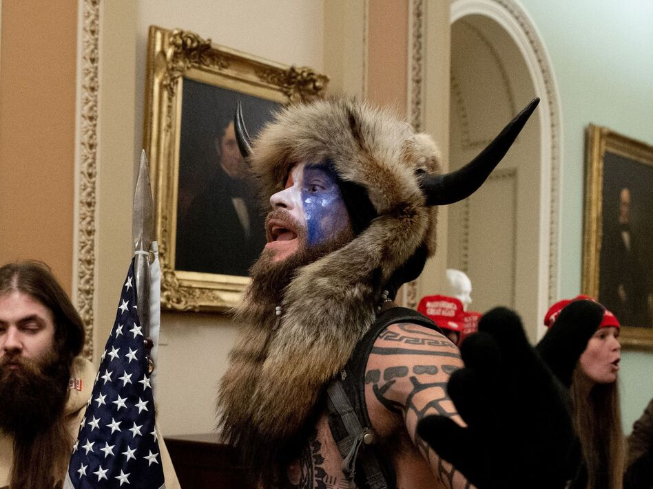"""The Justice Department announced Saturday that it had charged the man known as the """"QAnon shaman,"""" Jacob Anthony Chansley, in connection with the Capitol break-in on Wednesday. (Saul Loeb/AFP via Getty Images)"""