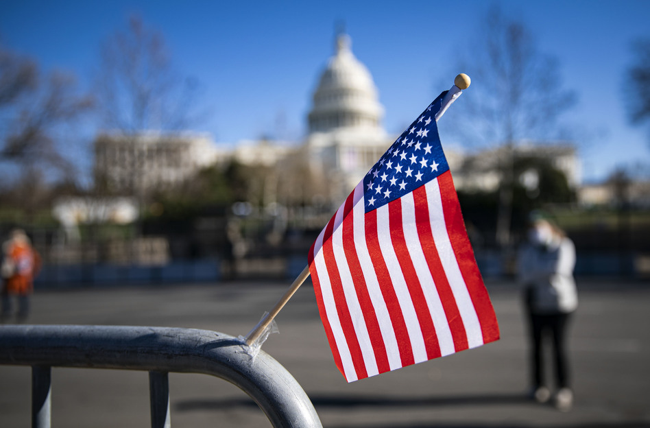 An American flag flies at a memorial for U.S. Capitol Police Officer Brian Sicknick, who was fatally injured when a pro-Trump mob stormed the U.S. Capitol on Wednesday. Another officer, Howard Liebengood, died Saturday in an off-duty death. (Al Drago/Getty Images)