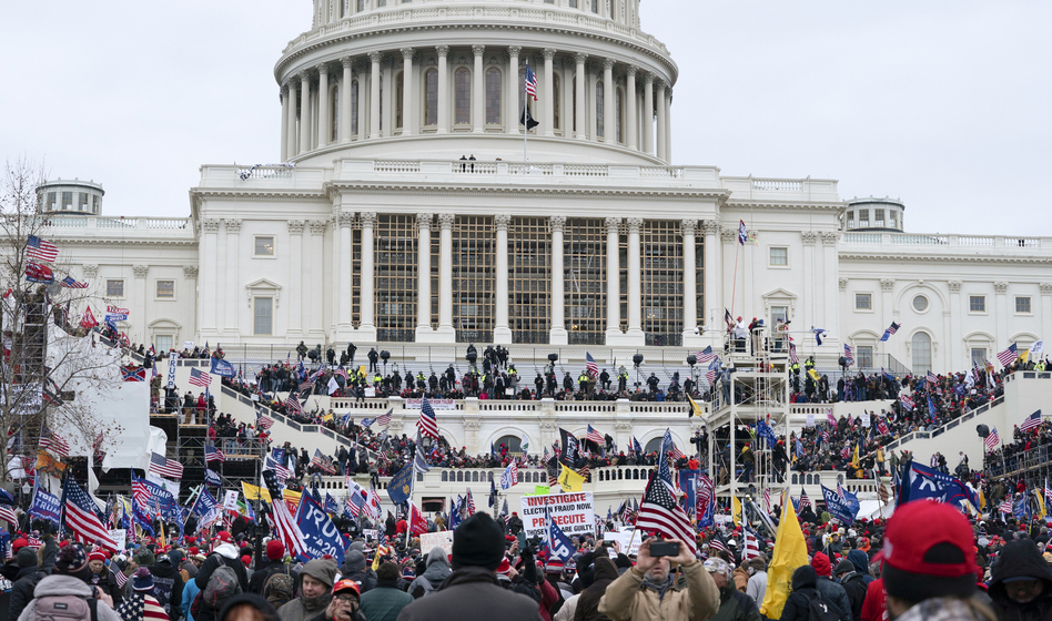 Researchers have used crowdsourcing to scrutinize video and photos from the riot at the Capitol on Jan. 6 and have identified some of those who took part. The researchers have shared their information with law enforcement. (Jose Luis Magana/AP)